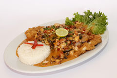 Peruvian Dish: Fried fish with sauce called A lo Macho. Sauce made of yellow chili (rocoto) and seafood added. Stock Image
