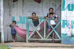 A Peruvian family in Indiana in Peru. A Peruvian family stand at the front of their home in the Amazon river town of Indiana, Peru Royalty Free Stock Photo