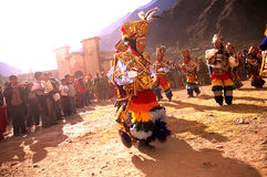 Peruvian festival. K'achampa dancers performing in the Fiesta Pentecostes in the Incan village of Ollantaytambo (Sacred Valley), Peru Royalty Free Stock Images