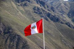 The Peruvian Flag. In the Andes Mountains of Peru royalty free stock images