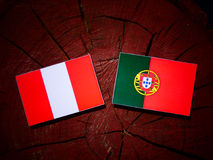 Peruvian flag with Portuguese flag on a tree stump isolated. Peruvian flag with Portuguese flag on a tree stump vector illustration