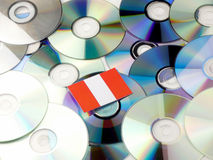 Peruvian flag on top of CD and DVD pile isolated on white Stock Image