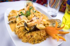 Peruvian food: arroz con mariscos. A delicious rice with seafood. Peruvian typical seafood Royalty Free Stock Image