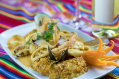 Peruvian food: arroz con mariscos. A delicious rice with seafood. Peruvian typical seafood Royalty Free Stock Photo