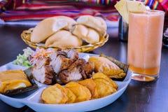 Peruvian food breakfast tamales con chicharron Royalty Free Stock Photos