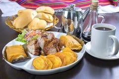 Peruvian food: Chicharrones, tamales, camote frito Stock Photography