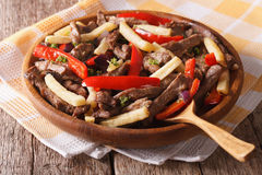 Peruvian Food: Lomo saltado close-up on a plate. Horizontal Royalty Free Stock Images