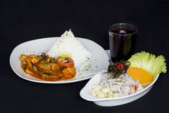 PERUVIAN FOOD: Lunch Cebiche and Picante de Mariscos with rice and a glass of chicha morada Royalty Free Stock Image