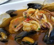 PERUVIAN FOOD: Lunch Picante de Mariscos. Peruvian Fish dish Royalty Free Stock Photography