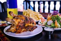 Peruvian food: Pollo a la brasa con inca kola Royalty Free Stock Photos