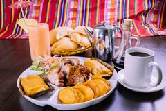 Peruvian food: breakfast tamales con chicharron royalty free stock images