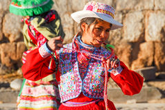 Peruvian Girl Dancing in Traditional Dress Stock Photo