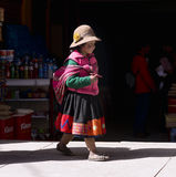 Peruvian girl dressed in colourful traditional handmade outfit. Stock Photography