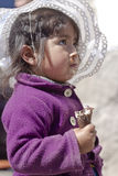 Peruvian girl eating ice-cream Royalty Free Stock Photos