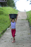 A Peruvian girl at Indiana in Peru. A Peruvian girl carrying washing down to the bank of the Amazon River in Indiana, Peru Stock Photography