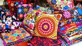 Peruvian handicraft: pillows and dolls in Indian market, Lima, Peru stock photography