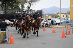 Peruvian horse police near the Government palace on the Plaza de Armas in Lima. Stock Images