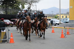 Peruvian horse police near the Government palace on the Plaza de Armas in Lima. Stock Photo