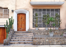 Peruvian house entrance. With stone stairs and cactus Royalty Free Stock Photo