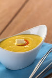 Peruvian Huancaina Sauce. (spicy cheese sauce) made of cheese, soda crackers, aji (Peruvian yellow chili pepper) and milk in a ceramic bowl with beater on the Stock Photos