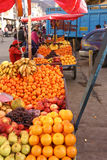 Peruvian Indian farmer sells fresh fruit Royalty Free Stock Photography