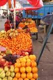 Peruvian Indian farmer sells fresh fruit Royalty Free Stock Photography