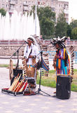 Peruvian Indians musicians on the fountains background Royalty Free Stock Photos