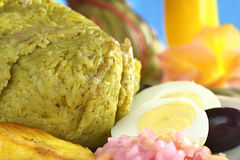 Peruvian Juane. Traditional Peruvian food called Juane from the jungle area, in which rice, eggs and different kinds of meat are wrapped into bijao leaves, and royalty free stock photography