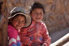 Peruvian kids in Machu Picchu site Stock Photos