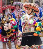 Peruvian ladies dressed in elaborate costumes walking to religious fesitval stock photos