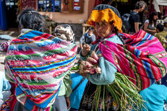 A Peruvian lady at the market in Pisac located in the Sacred Valley of the Incas in Peru. Royalty Free Stock Image