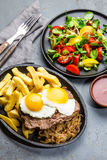 Peruvian Latin American food. Lomo a lo pobre. Beef whit fried potatoes french fry and eggs. served with salad. Top view Royalty Free Stock Photography