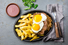 Peruvian Latin American food. Lomo a lo pobre. Beef whit fried potatoes french fry and eggs. Top view Royalty Free Stock Photos