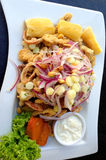 Peruvian lunch. With fired calamari, squid, ring onions, yuca and corn royalty free stock photography
