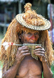A Peruvian man playing a pipe flute. Stock Photos