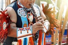 Peruvian man plays the flute. stock image