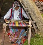 Peruvian man weaving. Cusco , Peru - May 26 2011 : Quechua Indian man weaving with strap loom Royalty Free Stock Photos