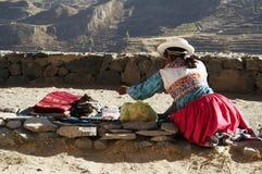 Peruvian market. Latin woman in the souvenir bazar Royalty Free Stock Photo