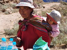 Peruvian Mother. Peruvian woman with child selling water in the Colca Canyon region of Peru - August, 2009 Royalty Free Stock Photography