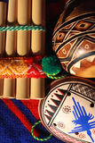 The Peruvian musical instruments. On dark blue poncho Stock Photos