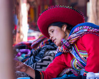 Peruvian native at the market selling her creations royalty free stock images