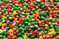 Peruvian Pepers. Green, red and yellow Peppers found in traditional market in urubamba, peru Stock Photography