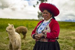 Peruvian poor woman smiling with traditional inca clothing. stock photography