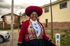Peruvian poor woman smiling with traditional inca clothing. Cusco, Peru - March 29 2019: Peruvian poor woman smiling with traditional inca clothing. Female royalty free stock photos