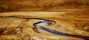Peruvian River. A river in Peru snakes through some brown lowlands Stock Photo