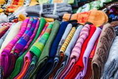 Peruvian scarves and gloves. In a street market stock photo