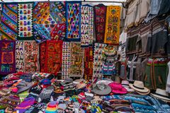 Peruvian shop with handmade hats and scarfs. Peruvian street market shop with traditional colorful handmade clothing, hats and scarfs, viewed in full frame stock photo