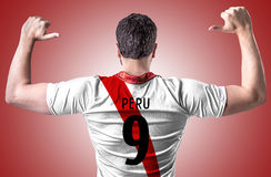 Peruvian soccer player on red background Stock Photos