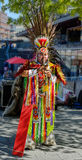 Peruvian street musician with pan flute performing music and dan Royalty Free Stock Images