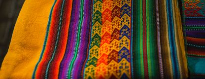 Peruvian traditional colourful native handicraft textile fabric at market in Machu Picchu, one of the New Seven Wonder of The royalty free stock photography